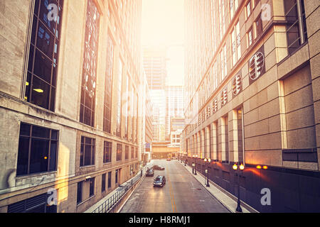 Retro old film style photo of a street in Chicago at sunset, USA. - Stock Photo