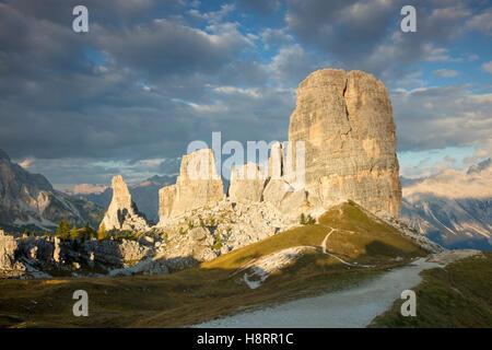 Evening sunlight over the Cinque Torri, Dolomite Mountains, Belluno, Veneto, Italy - Stock Photo