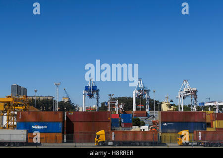 Shipping containers, trucks and cranes at Leixões port in Matosinhos, Portugal, Europe - Stock Photo