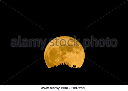People watching as the Super Moon Rises over the Catalina Mountains north of Tucson, Arizona, November 14th 2016 - Stock Photo