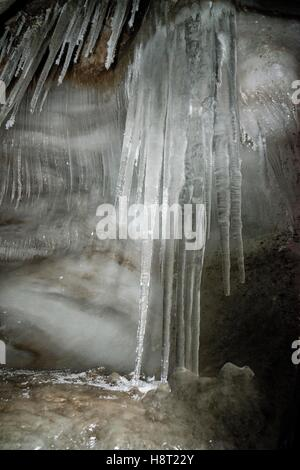 Close up of well formed icicles in an ice cave of Larsbreen, Svalbard, Spitsbergen, Norway Nahaufnahme Eiszapfen - Stock Photo