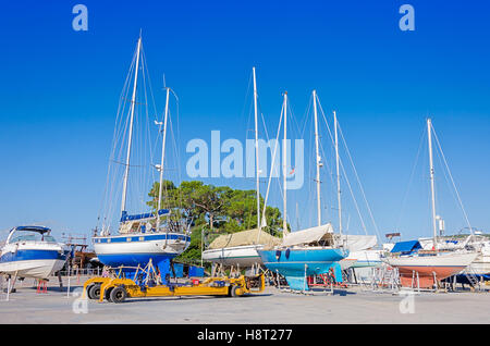Shipyard for repair yacht and boats. Pier with ships. - Stock Photo