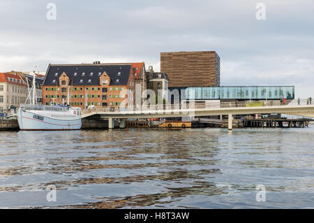 People crossing Inderhavnsbroen (The Inner Harbour Bridge) in Copenhagen, Denmark - Stock Photo