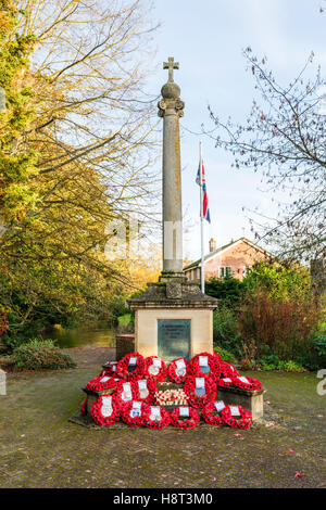 Typical First World War (Great War 1914-1918) war memorial with many poppy wreaths laid on Remembrance Sunday, Hungerford, - Stock Photo