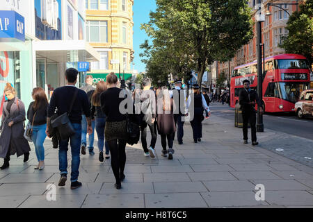 Shoppers and Bus on Oxford Street, London, England, UK - Stock Photo