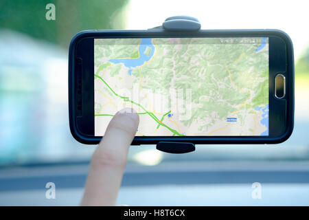 Car driver using a gps mobile app for traveling - Stock Photo