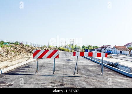 Closed enter at construction zone, work in progress, sign with boundary are symbols of caution, road resurfacing - Stock Photo