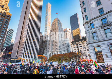 NEW YORK CITY - NOVEMBER 13, 2016:  Crowds on 5th Avenue march towards Trump Tower to protest President-elect Donald - Stock Photo
