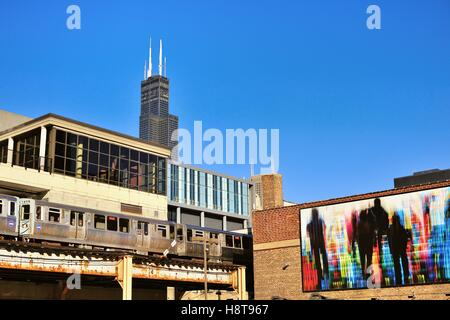 The Willis Tower (formerly Sears Tower) towering over the south Loop area of Chicago as a CTA rapid transit train - Stock Photo
