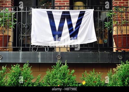Homeowners near Wrigley Field were flying flags in support of the Chicago Cubs during the 2016 playoffs and World - Stock Photo