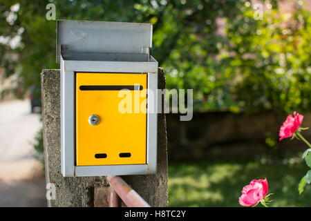 Mailbox in front of the house, waiting for letters - Stock Photo