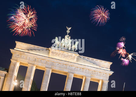 Firework over Brandenburg Gate in Berlin.  New years Eve in Germany - Stock Photo