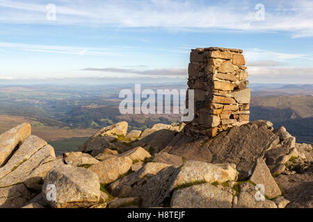 The stone built Trig Point on the summit of Moel Siabod - Stock Photo