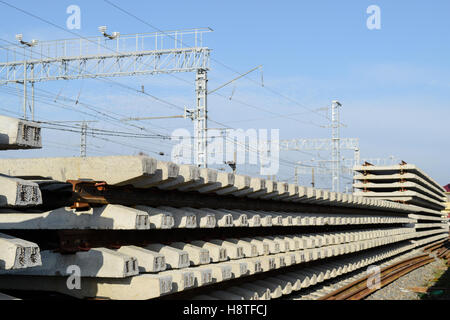 New rails and sleepers. The rails and sleepers are stacked on each other. Renovation of the railway. Rail road for - Stock Photo