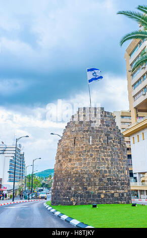 The preserved ruins of the Ottoman watchtower in the modern street of Tiberias, Israel. - Stock Photo