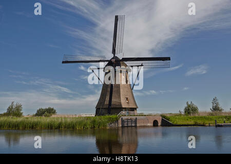 Line of windmills next to a canal at Kinderdijk, the Netherlands. - Stock Photo