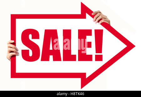 Woman hands holding a arrow made of red paper with the word sale!. Isolated on white. - Stock Photo