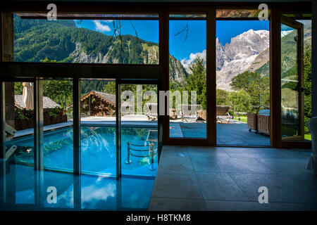 Vision on Brenva glacier and Veny valley from the pool of the Auberge de la Maison, Entreves, Courmayeur. - Stock Photo
