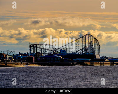 Big dipper, Pleasure Beach at sunset, Blackpool, Lancashire, UK. - Stock Photo