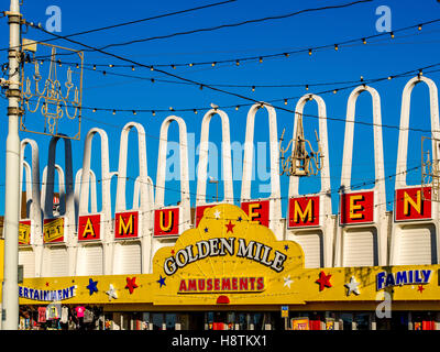 Golden Mile Amusement Arcade sign on seafront, Blackpool, Lancashire, UK. - Stock Photo