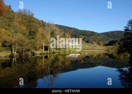 Eighteenth-century dwelling host , Priory Hérival and Pond of Hériva , Girmont -Val- d'Ajol , Vosges, France - Stock Photo