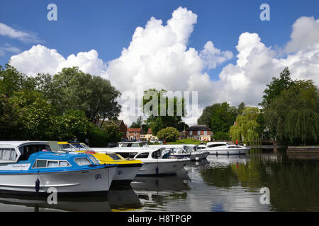 Hire boats moored at Loddon Staithe on the River Chet, Norfolk Broads - Stock Photo