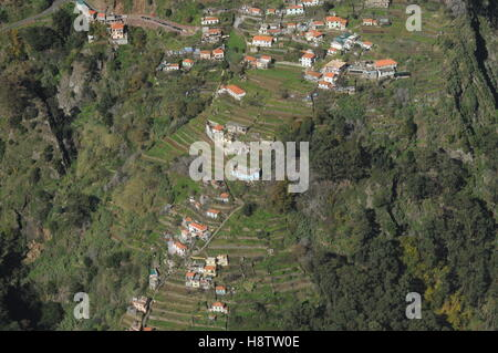 Houses on mountainside terraces near Curral das Freiras, Madeira - Stock Photo