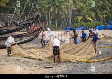 Fishermen, Varkala beach, Kerala, South India - Stock Photo
