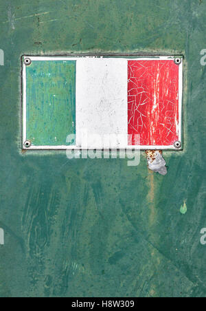 Italian flag on rusty old enamel sign - Stock Photo