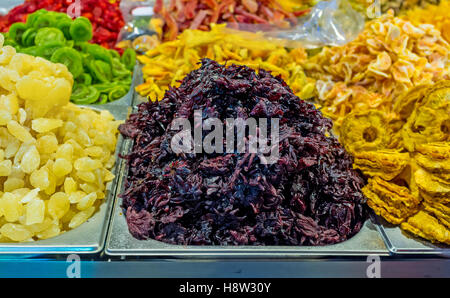 The candied hibiscus flowers and dried fruits in the stall of Mahane Yehuda Market, Jerusalem, Israel. - Stock Photo
