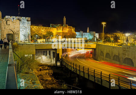 The David's fortress in the bright evening illumination with the Mamilla Road on the foreground, Jerusalem, Israel. - Stock Photo