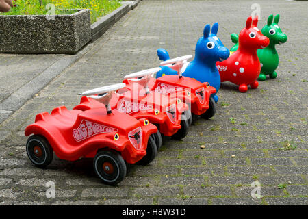 toys, bobby car, bouncy horse, made of plastic, ready, waiting at a kids birthday party, - Stock Photo