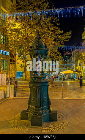 The scenic fountain in Ben Yehuda  pedestrian street, decorated with the scenic women sculptures - Stock Photo