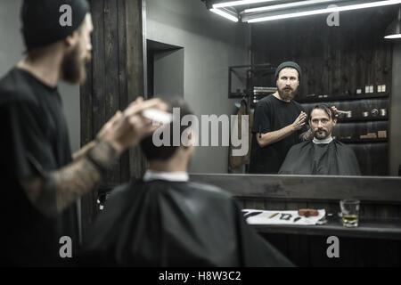 Stylish man in barbershop - Stock Photo