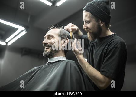 Cutting hair in barbershop - Stock Photo
