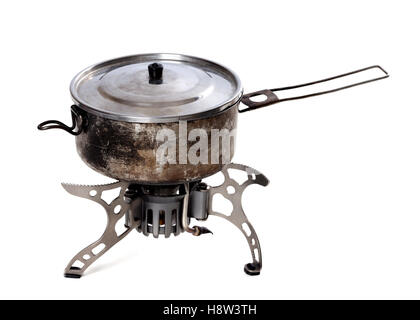 Camping gas stove and old sooty hiking pan. Isolated on white background - Stock Photo