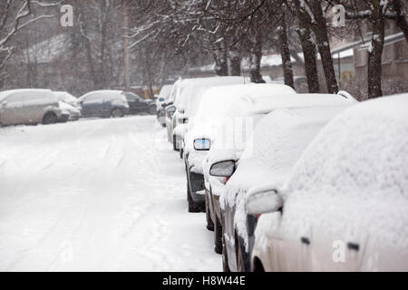 parked cars covered with snow - snow storm - Stock Photo
