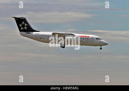 Swiss Global Air Lines British Aerospace Avro RJ100 at Milan - Malpensa (MXP / LIMC) Italy - Stock Photo