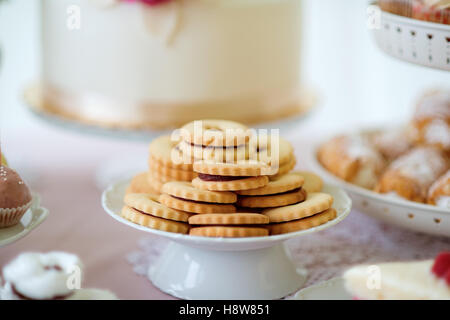 Close up, sandwich cookies filled with jam. Studio shot. - Stock Photo