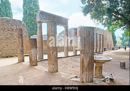 The large archaeological site of ancient excavated town of Pompeii, that was buried under volcanic ash for the centuries - Stock Photo