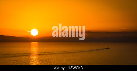 Sunset over Poole Bay in Bournemouth - Stock Photo