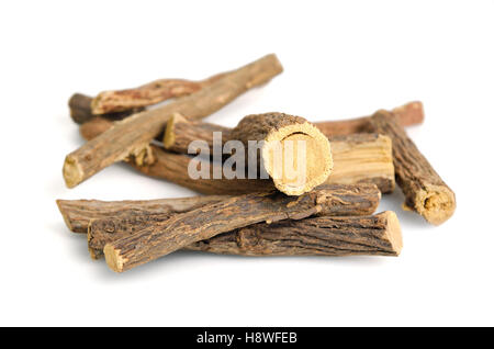 Heap of liquorice sticks isolated on white (Also called as Glycyrrhiza acanthocarpa, Glycyrrhiza glabra, glabra - Stock Photo