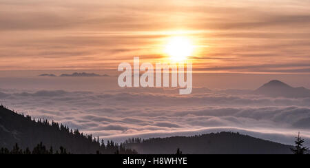 sunrise from Chata pod Chlebom in autumn Mala Fatra mountains in Slovakia with colorful sky, sun and only highest - Stock Photo