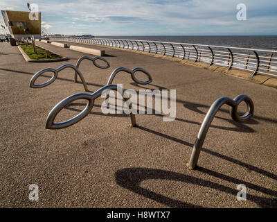 Modern bike racks along seafront at Blackpool, Lancashire, UK. - Stock Photo