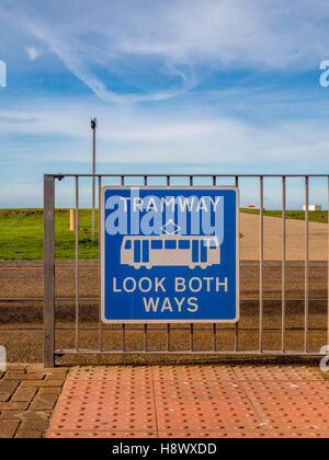 TRAMWAY LOOK BOTH WAYS sign with tram tracks, Blackpool, Lancashire, UK. - Stock Photo