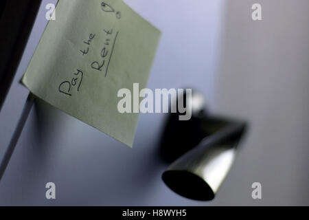 Note by the door Pay Rent - Stock Photo