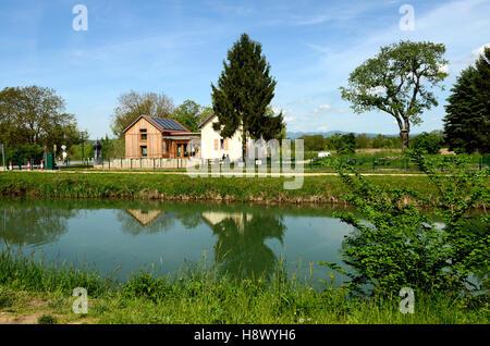 lock keeper house Canal de Huningue - Alsace France - Stock Photo