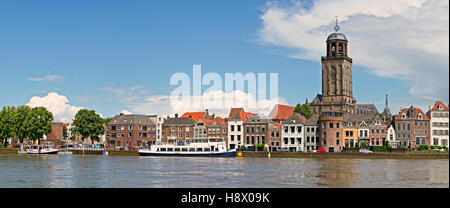 Panoramic view of the medieval Dutch city Deventer with the Great Church of Lebuineskerk alongside the IJssel river - Stock Photo