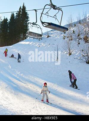 People on a mountain slope at ski resort in Bukovel. Ukraine - Stock Photo