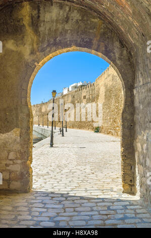 The stone arch was the entrance to the old port in the middle ages, Bizerte, Tunisia. - Stock Photo